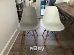 Beautiful reclaimed wood dining table and Eames-style chairs