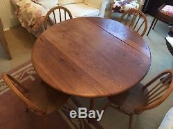 Ercol dining suite 4 ft round table and four chairs