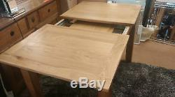 Extending Solid Oak Dining Table And Six Black Bonded Leather Chairs 120/165CM
