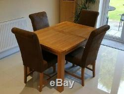 Extending solid Italian oak dining table and 6 brown chairs