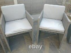 Rattan garden furniture set with table, 4 chairs and cushions