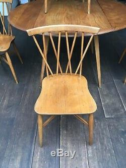Set Of 4 Mid Century Ercol Candlestick Chairs And Drop Leaf Round Table 1960s