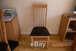 Solid oak dining room table and 8 chairs (extendable) really good condition