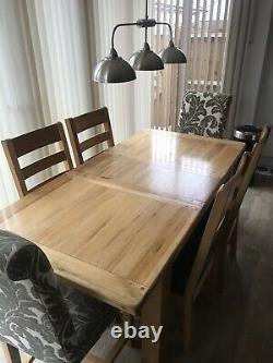 Solid oak dining table (extendable) and chairs