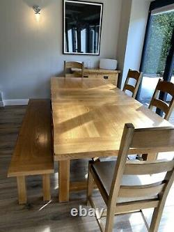 Solid oak extending dining table and 4 chairs With Bench