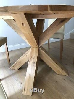 Solid round oak dining table and 4 chairs